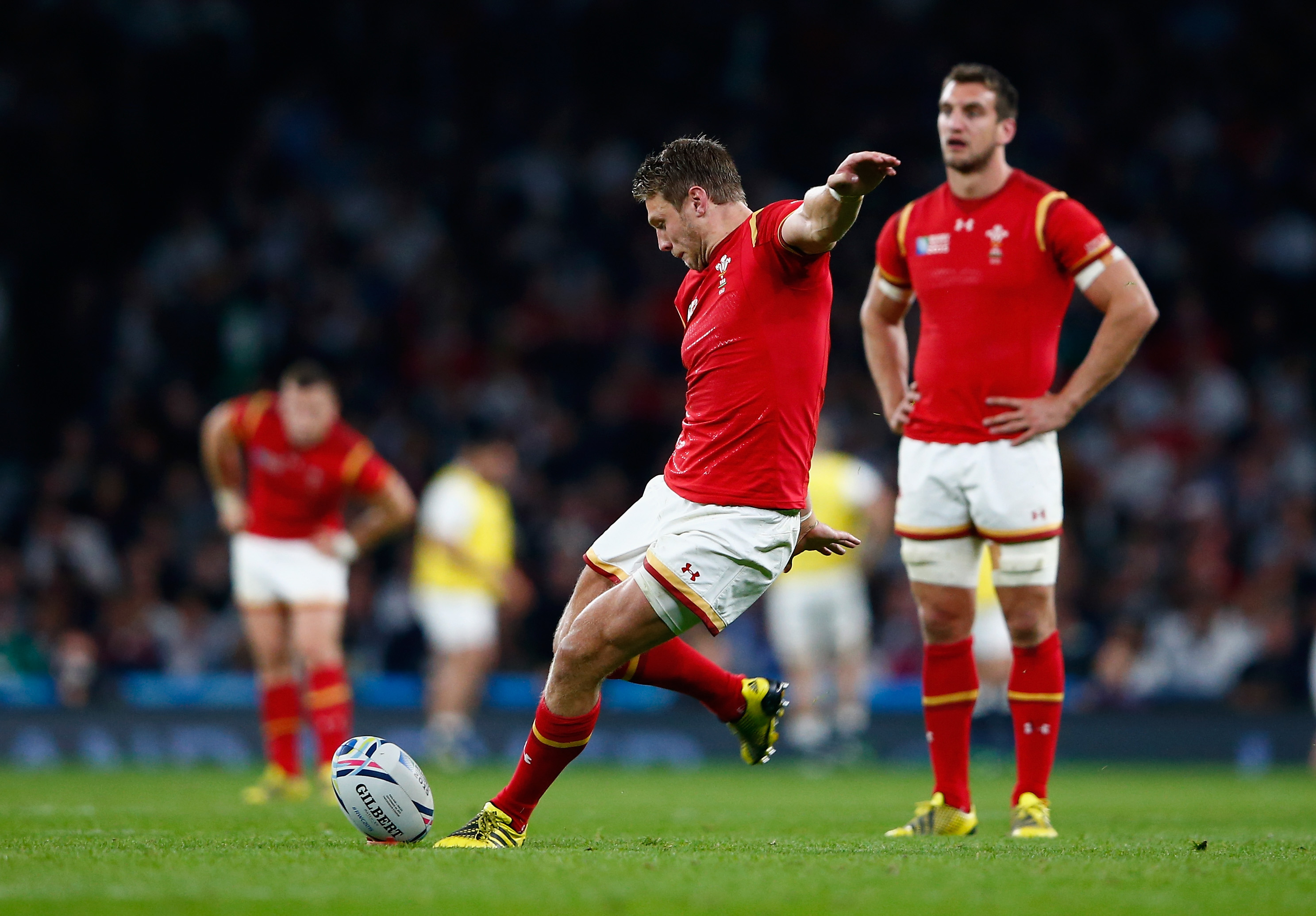 LONDON, ENGLAND - SEPTEMBER 26: Dan Biggar of Wales kicks a penalty during the 2015 Rugby World Cup Pool A match between England and Wales at Twickenham Stadium on September 26, 2015 in London, United Kingdom. (Photo by Shaun Botterill/Getty Images)