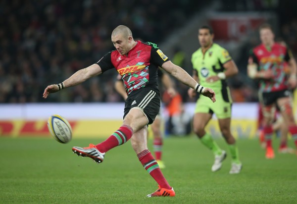 LONDON, ENGLAND - DECEMBER 27: Mike Brown of Harlequins kicks the ball upfield during the Aviva Premiership match between Harlequins and Northampton Saints at Twickenham Stadium on December 27, 2014 in London, England. (Photo by David Rogers/Getty Images)