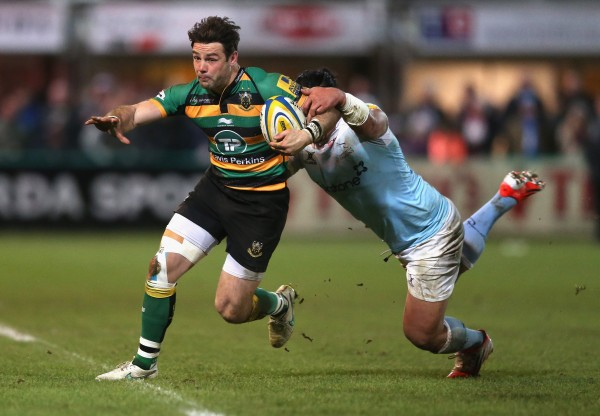 NORTHAMPTON, ENGLAND - JANUARY 02: Ben Foden of Northampton is tackled by Anitelea Tuilagi during the Aviva Premiership match between Northampton Saints and Newcastle Falcons at Franklin's Gardens on January 2, 2015 in Northampton, England. (Photo by David Rogers/Getty Images)