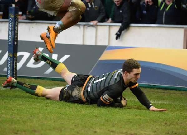 NORTHAMPTON, ENGLAND - JANUARY 24: George North of Northampton Saints dives in to score a try during the European Rugby Champions Cup match between Northampton Saints and Racing Metro 92 at Franklin's Gardens on January 24, 2015 in Northampton, England. (Photo by Tony Marshall/Getty Images)