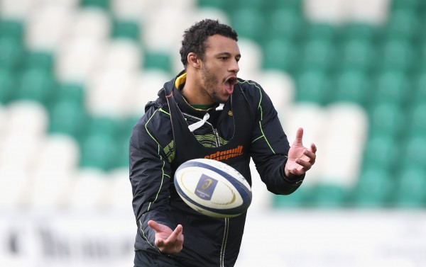 NORTHAMPTON, ENGLAND - APRIL 01: Courtney Lawes passes the ball during the Northampton Saints training session held on April 1, 2015 in Northampton, England. (Photo by David Rogers/Getty Images)