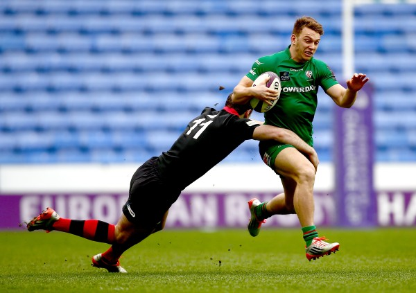 READING, ENGLAND - APRIL 05: Alex Lewington of London Irish is tackled by Tim Visser of Edinburgh during the European Rugby Challenge Cup Quarter Final between London Irish and Edinburgh Rugby at the Madejski Stadium on April 5, 2015 in Reading, England. (Photo by Jordan Mansfield/Getty Images)