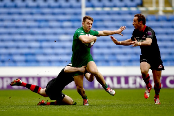 READING, ENGLAND - APRIL 05: Alex Lewington of London Irish is tackled by Tim Visser (L) and Andries Strauss of Edinburgh (R) during the European Rugby Challenge Cup Quarter Final between London Irish and Edinburgh Rugby at the Madejski Stadium on April 5, 2015 in Reading, England. (Photo by Jordan Mansfield/Getty Images)