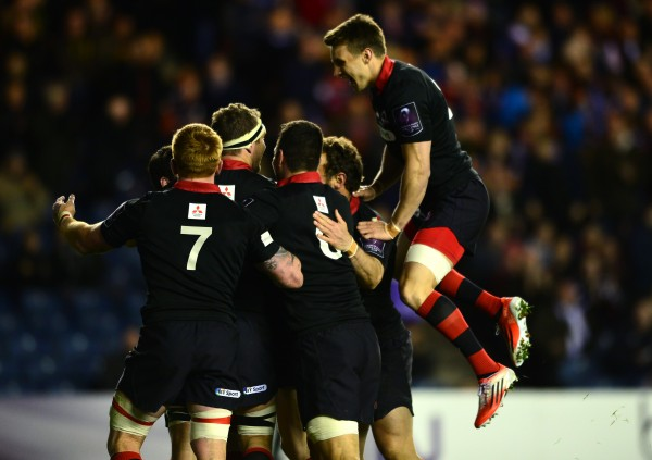 EDINBURGH, SCOTLAND - APRIL 17: The Edinburgh Rugby team celebrate with Sam Hadalgo-Clyne after he scored a try in the second half during the European Rugby Challenge Cup Semi Final match, between Edinburgh Rugby and Newport Gwent Dragons at Murrayfield Stadium on April 17, 2015 in Edinburgh Scotland. (Photo by Mark Runnacles/Getty Images)