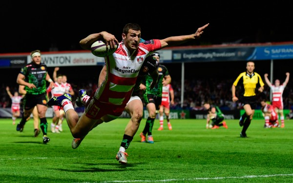 GLOUCESTER, ENGLAND - APRIL 18:  Jonny May of Gloucester dives over for the final try during the European Rugby Challenge Cup semi final match between Gloucester Rugby and Exeter Chiefs at Kingsholm Stadium on April 18, 2015 in Gloucester, England.  (Photo by Stu Forster/Getty Images)