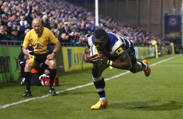 BATH, ENGLAND - APRIL 24: Semesa Rokoduguni of Bath dives in to score their fifth try during the Aviva Premiership match between Bath and London Irish at the Recreation Ground on April 24, 2015 in Bath, England. (Photo by David Rogers/Getty Images)