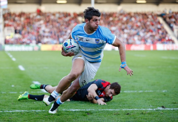GLOUCESTER, ENGLAND - SEPTEMBER 25: Tomas Cubelli of Argentina is tackled by Vasil Lobzhanidze of Georgia on the way to scoring his teams second try during the 2015 Rugby World Cup Pool C match between Argentina and Georgia at Kingsholm Stadium on September 25, 2015 in Gloucester, United Kingdom. (Photo by Stu Forster/Getty Images)