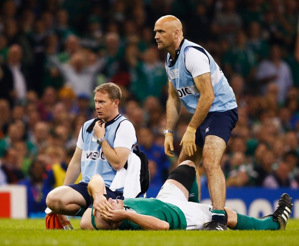 CARDIFF, WALES - OCTOBER 11: Medics call for a stretcher as Paul O'Connell of Ireland lies injured during the 2015 Rugby World Cup Pool D match between France and Ireland at Millennium Stadium on October 11, 2015 in Cardiff, United Kingdom. (Photo by Laurence Griffiths/Getty Images)