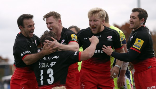 BARNET, ENGLAND - OCTOBER 17: Tim Streather (No 13) of Saracens celebrates with his team-mates after he scores a try for his side during the Aviva Premiership match between Saracens and Sale Sharks at Allianz Park on October 17, 2015 in Barnet, England. (Photo by Clint Hughes/Getty Images)