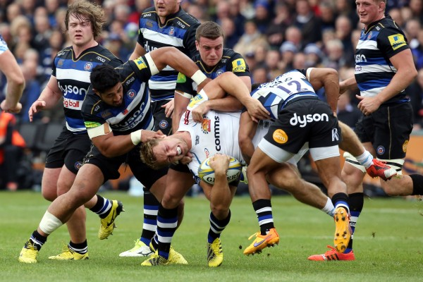 BATH, ENGLAND - OCTOBER 17: Sam Hill of Exeter Chiefs is held by Alafoli Faosiliva, George Ford and Kyle Eastmond of Bath Rugby during the Aviva Premiership match between Bath Rugby and Exeter Chiefs at the Recreation Ground on October 17, 2015 in Bath, England. (Photo by David Jones/Getty Images)