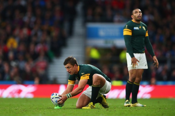 LONDON, ENGLAND - OCTOBER 17: Handre Pollard of South Africa lines up a kick watched by Bryan Habana of South Africa during the 2015 Rugby World Cup Quarter Final match between South Africa and Wales at Twickenham Stadium on October 17, 2015 in London, United Kingdom. (Photo by Paul Gilham/Getty Images)