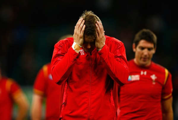 LONDON, ENGLAND - OCTOBER 17: A dejected Dan Biggar of Wales holds his head in his hands following defeat in the 2015 Rugby World Cup Quarter Final match between South Africa and Wales at Twickenham Stadium on October 17, 2015 in London, United Kingdom. (Photo by Dan Mullan/Getty Images)