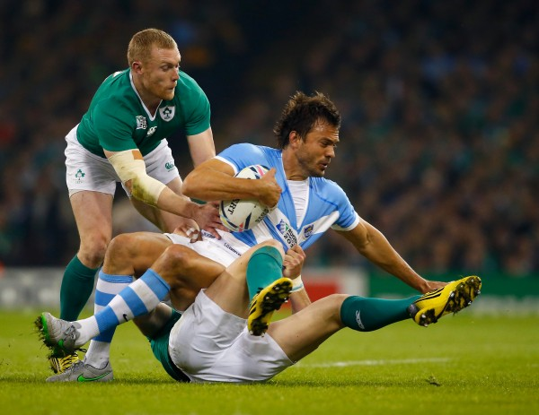 CARDIFF, WALES - OCTOBER 18: Juan Martin Hernandez of Argentina is tackled by Robbie Henshaw and Keith Earls of Ireland during the 2015 Rugby World Cup Quarter Final match between Ireland and Argentina at the Millennium Stadium on October 18, 2015 in Cardiff, United Kingdom. (Photo by Laurence Griffiths/Getty Images)