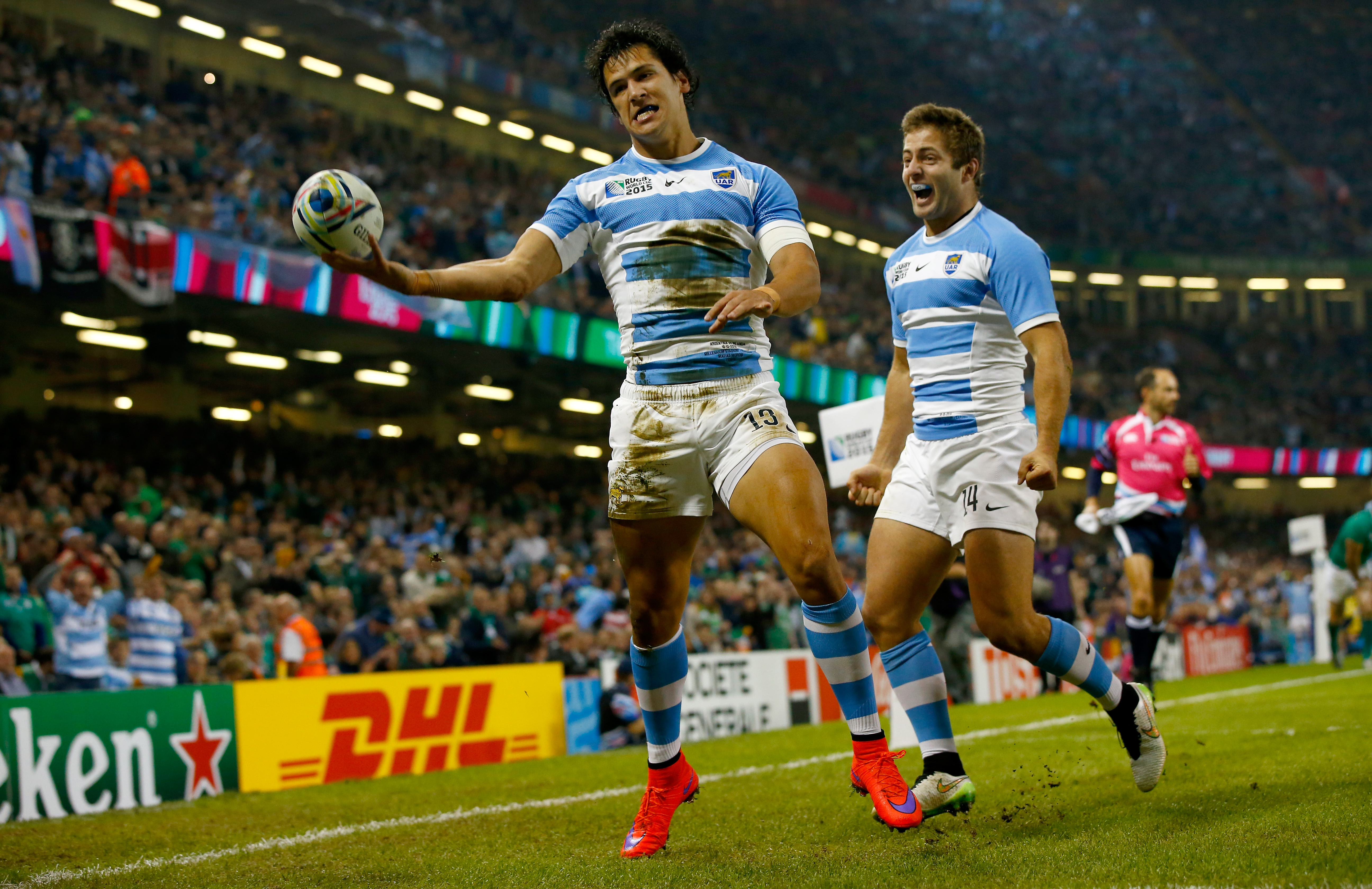 CARDIFF, WALES - OCTOBER 18: Matias Moroni of Aargentina (l) celebrates after scoring the opening try during the 2015 Rugby World Cup Quarter Final match between Ireland and Argentina at Millennium Stadium on October 18, 2015 in Cardiff, United Kingdom. (Photo by Stu Forster/Getty Images)