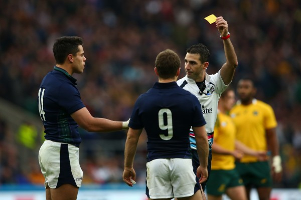 LONDON, ENGLAND - OCTOBER 18: Referee Craig Joubert shows the yellow card to Sean Maitland (L) of Scotland during the 2015 Rugby World Cup Quarter Final match between Australia and Scotland at Twickenham Stadium on October 18, 2015 in London, United Kingdom. (Photo by Dan Mullan/Getty Images)
