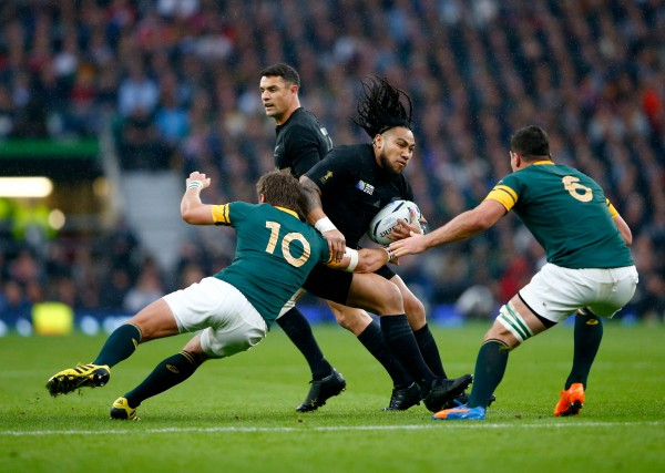 LONDON, ENGLAND - OCTOBER 24: Ma'a Nonu of the New Zealand All Blacks is tackled by Handre Pollard (l) and Francois Louw (6) of South Africa during the 2015 Rugby World Cup Semi Final match between South Africa and New Zealand at Twickenham Stadium on October 24, 2015 in London, United Kingdom. (Photo by Chris Lee - World Rugby/World Rugby via Getty Images)