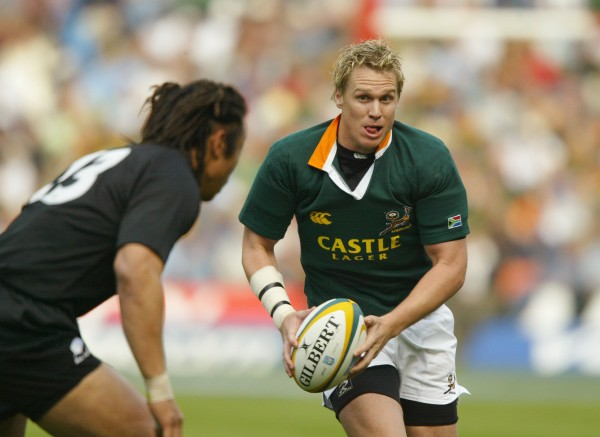 JOHANNESBURG, SOUTH AFRICA - AUGUST 14: Jan De Villiers of South Africa takes on New Zealand's Tana Umaga during the Tri-Nations Rugby Union International between South Africa and New Zealand at Ellis Park on August 14, 2004 in Johannesburg, South Africa. (Photo by David Rogers/Getty Images)