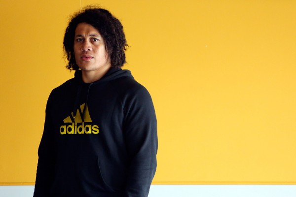 WELLINGTON, NEW ZEALAND - NOVEMBER 27: TJ Ioane of the Highlanders looks on during the New Zealand Rugby Union induction day at Westpac Stadium on November 27, 2013 in Wellington, New Zealand. (Photo by Hagen Hopkins/Getty Images)