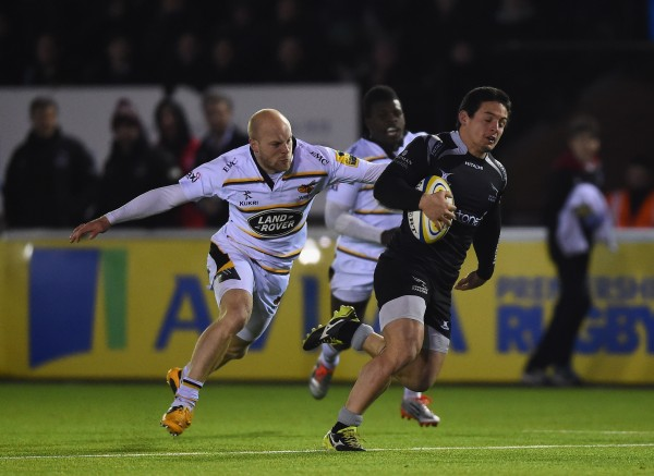 NEWCASTLE UPON TYNE, ENGLAND - FEBRUARY 20: Juan Pablo Socino of Newcastle breaks past Joe Simpson of Wasps to score a second half try during the Aviva Premiership match between Newcastle Falcons and Wasps at Kingston Park on February 20, 2015 in Newcastle upon Tyne, England. (Photo by Laurence Griffiths/Getty Images)