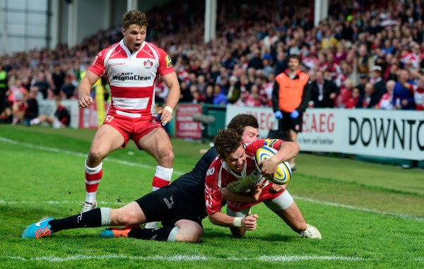 GLOUCESTER, ENGLAND - APRIL 25: Gloucester player Billy Burns goes over for the winning try during the Aviva Premiership match between Gloucester Rugby and Newcastle Falcons at Kingsholm Stadium on April 25, 2015 in Gloucester, England. (Photo by Stu Forster/Getty Images)