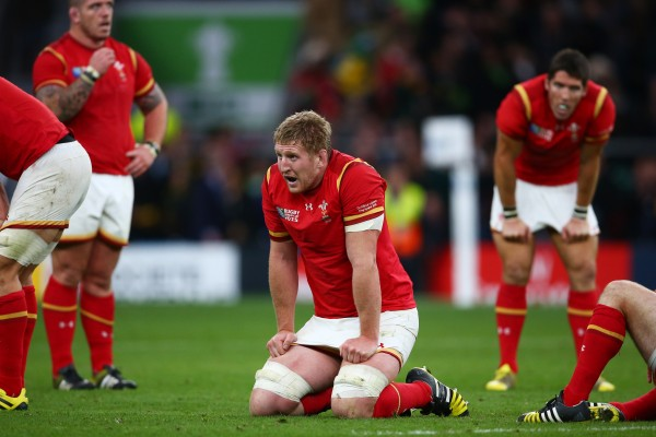 LONDON, ENGLAND - OCTOBER 17: A dejected Bradley Davies of Wales kneels on the pitch following the 2015 Rugby World Cup Quarter Final match between South Africa and Wales at Twickenham Stadium on October 17, 2015 in London, United Kingdom. (Photo by Steve Bardens - World Rugby/World Rugby via Getty Images)