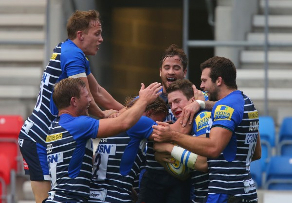SALFORD, ENGLAND - NOVEMBER 1: Sale Sharks players congratulate Sam James, second from right, after he scored his side's first try of the match during the Aviva Premiership match between Sale Sharks and Northampton Saints at the AJ Bell Stadium on November 1, 2015 in Salford, England. (Photo by Dave Thompson/Getty Images)