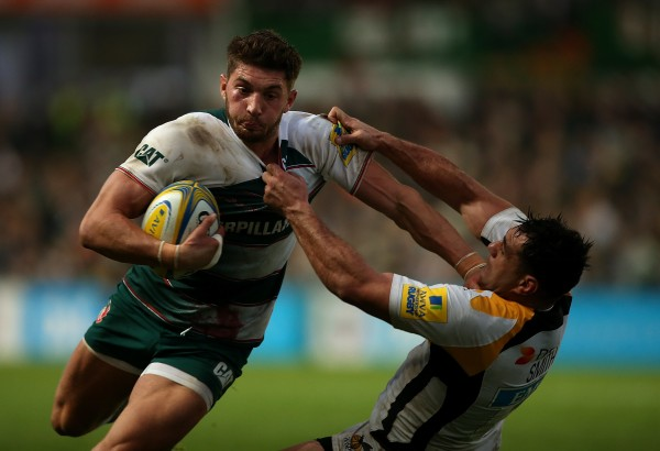 LEICESTER, ENGLAND - NOVEMBER 01: Owen Williams of Leicester hands off the tackle of George Smith of Wasps during the Aviva Premiership match between Leicester Tigers and Wasps at Welford Road on November 1, 2015 in Leicester, England. (Photo by Ben Hoskins/Getty Images)