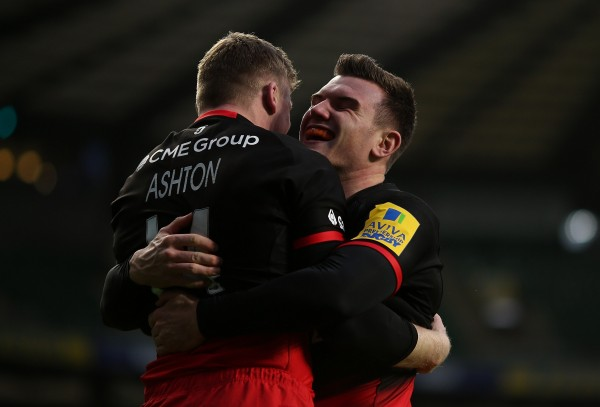 LONDON, ENGLAND - NOVEMBER 28: Chris Ashton of Saracens celebrates with team mate Ben Spencer after scoring a try during the Aviva Premiership match between Saracens and Worcester Warriors at Twickenham Stadium on November 28, 2015 in London, England. (Photo by Ben Hoskins/Getty Images)