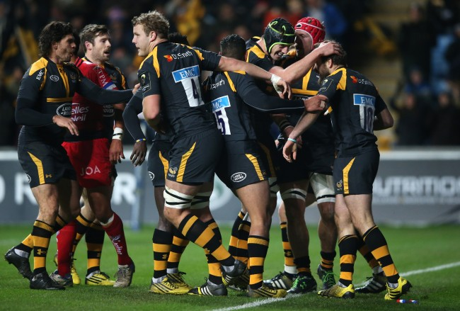 COVENTRY, ENGLAND - NOVEMBER 22: Ruaridh Jackson (R) of Wasps is mobbed by team mates after scoring a try during the European Rugby Champions Cup match between Wasps and Toulon at the Ricoh Arena on November 22, 2015 in Coventry, England. (Photo by David Rogers/Getty Images)