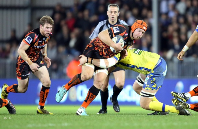 EXETER, ENGLAND - DECEMBER 12: Thomas Waldrom of Exeter Chiefs runs at the Clermont Auvergne defence during the European Rugby Champions Cup match between Exeter Chiefs and Clermont Auvergne at Sandy Park on December 12, 2015 in Exeter, England. (Photo by David Jones/Getty Images)