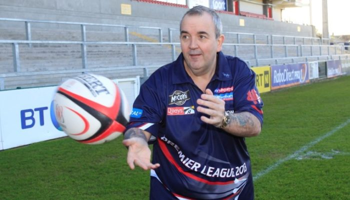 phil-taylor-on-the-pitch-at-ulster-rugby-club-at-the-mccoys-premier-league-darts-launch_k44ynxy1olqe11w05tsoejxz8