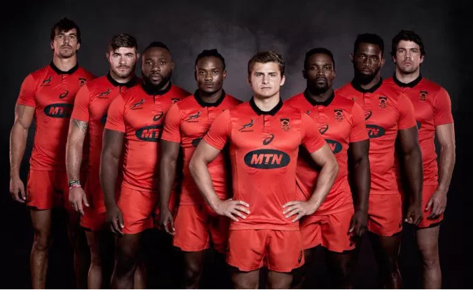 "5a7374e36da ""We chose the colours of the flag as a uniting symbol and believed that red  made the boldest statement as a tribute to the achievement of rugby unity,  ..."