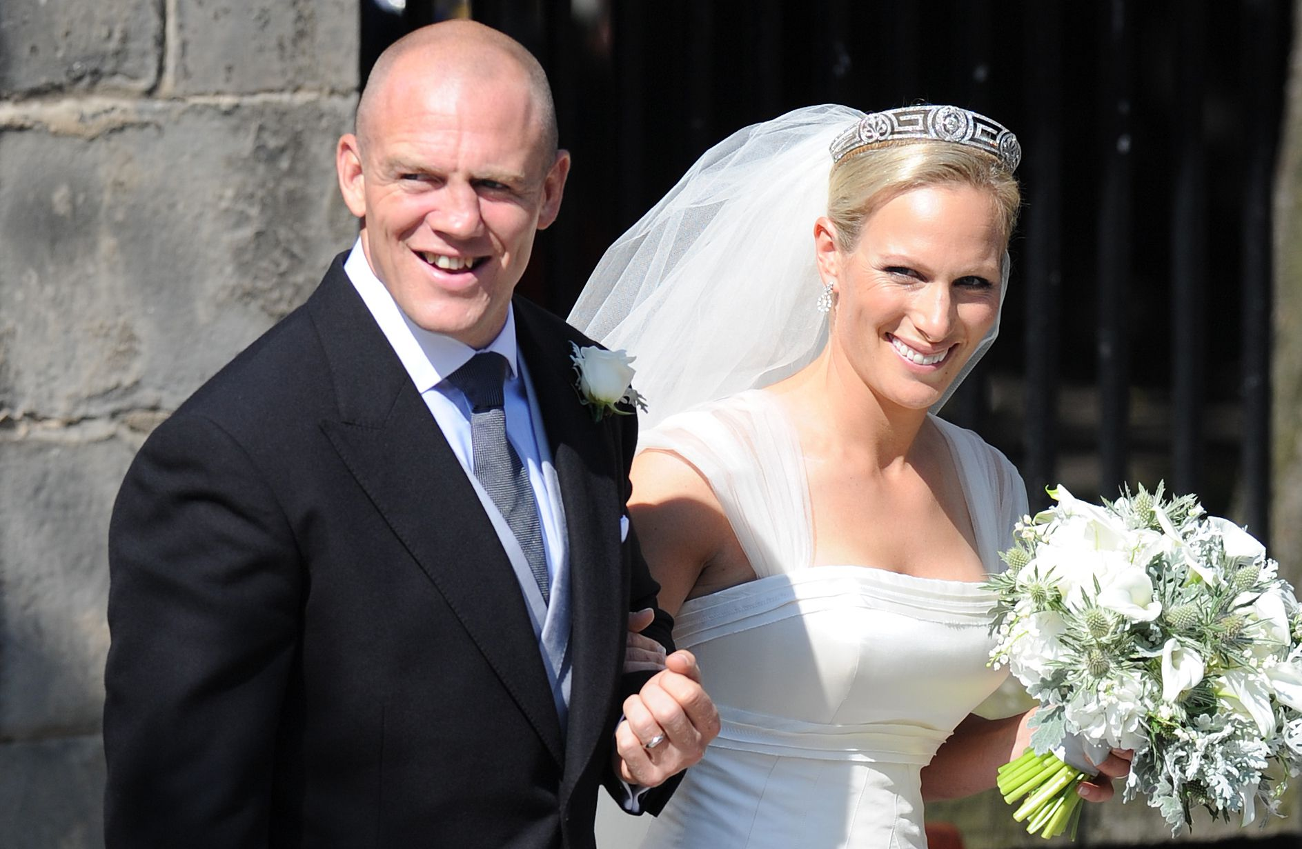 This image has an empty alt attribute; its file name is mike-tindall-and-zara-phillips-emerge-from-canongate-kirk-news-photo-809422258-1529510670.jpg